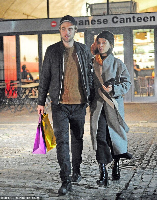 Robert Pattinson and fiancee FKA Twigs silenced any claims there is trouble in their relationship as they put on a loving display after heading out for dinner together in London on Wednesday