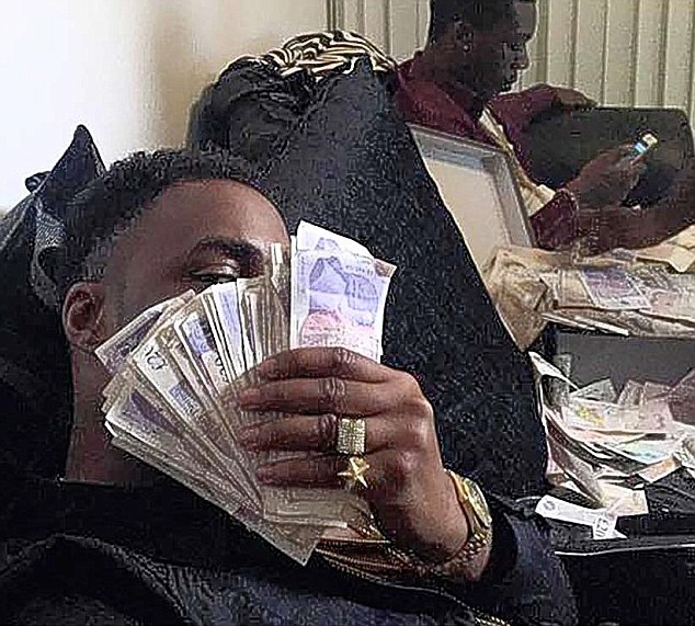 Facebook messages and images of cash (pictured) tempt teenagers to launder money for criminal gangs