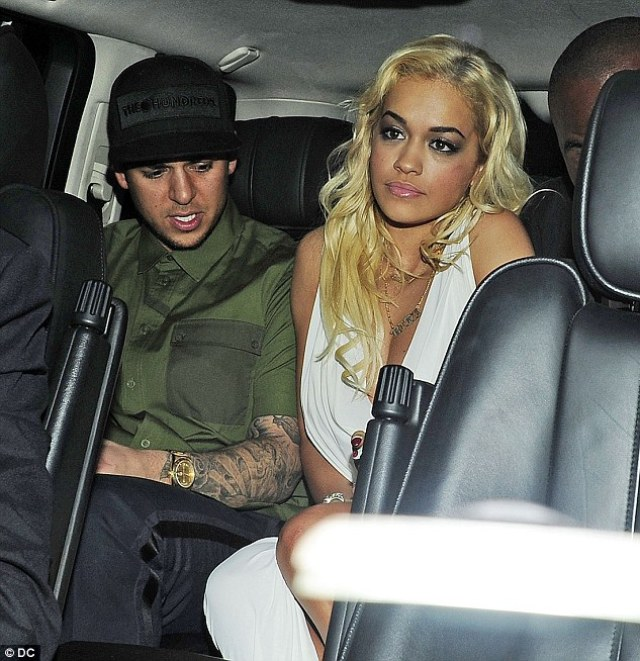 New flame: The Kardashian sibling then changed the tattoo to honor new galpal Rita Ora. Rob and the singer are pictured in London in 2012