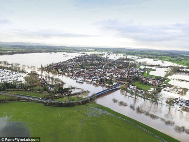 Priorities: Critics said taxpayers would be concerned to see so much of their money disappearing abroad when so many had seen their homes devastated by flooding. Pictured,Upton-upon-Severn, Worcestershire