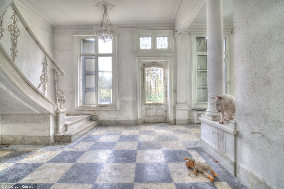 This stunning forsaken castle in Belgium appears to be in beautiful condition still. Claire perches on a ledge and stares down at a dirty doll