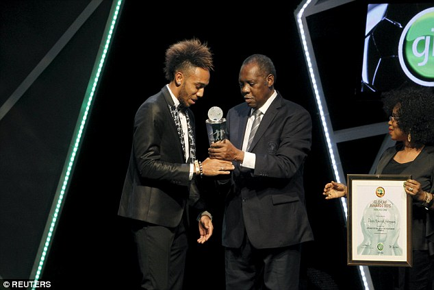 Pierre-Emerick Aubameyang (left) receives the African Footballer of the Year award from Issa Hayatou