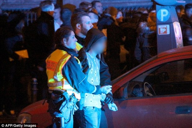 Taunted: Police have revealed how the violent crowd, which was 'mainly' made up of migrants, openly mocked them as they tried to regain control of Cologne city centre in the run up to midnight on New Year's Eve