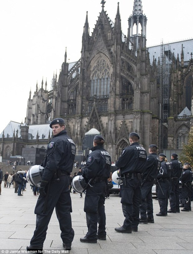 German police in Cologne's Cathedral Square, Germany, after hundreds of women were assaulted by gangs of men on New Years Eve . The Cologne police force has also been accused of deliberately hushing up the New Year scandal