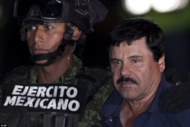El Chapo showed little emotion as he was dragged across the runway in front of dozens of Press and government officials