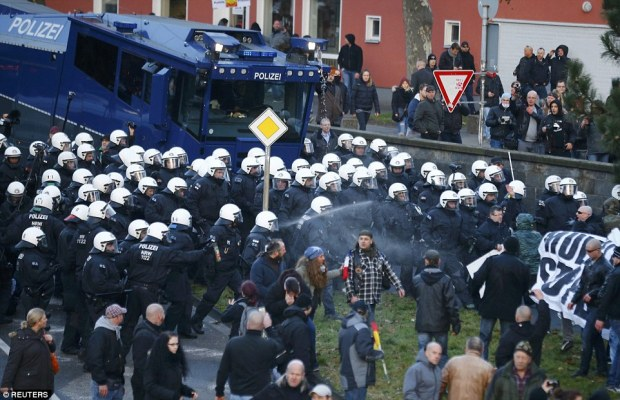 Police use pepper spray against supporters of anti-immigration right-wing movement Pegida