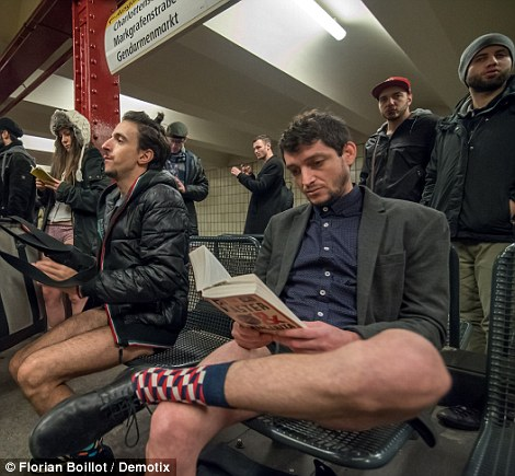 A lot of people participating in the trouserless ride read books to act as if they didn't notice they didn't have their bottoms on