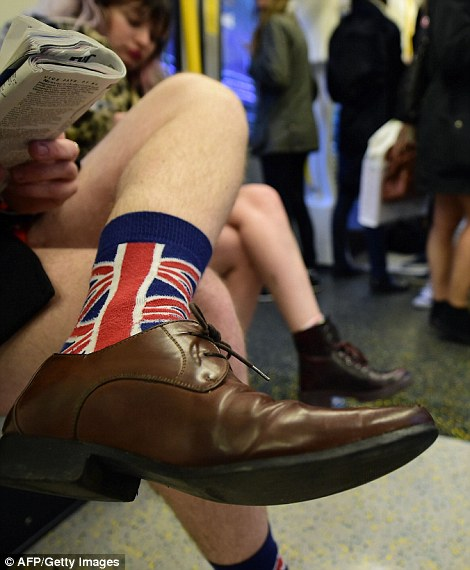 This man shows his national pride while riding the tube without trousers