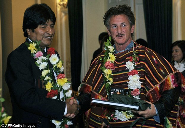 Penn shakes hands with Bolivian president Evo Morales at the presidential palace in La Paz in 2012