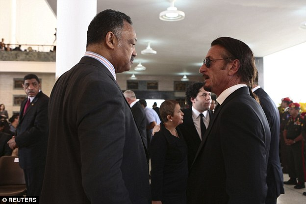 He is pictured here with the Rev Jesse Jackson at Chavez's funeral in 2011