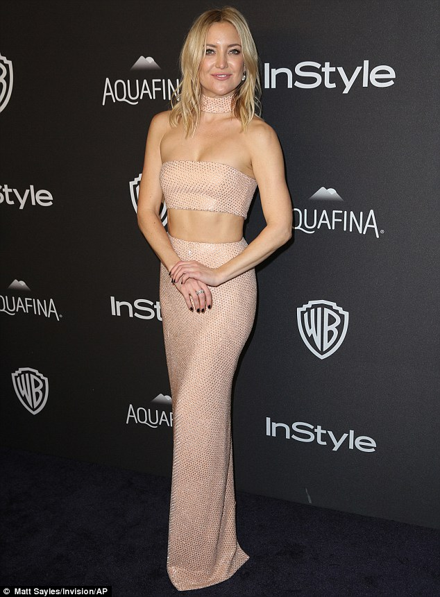 Just playing with her toyboy: Kate Hudson, here at the Instyle and Warner Bros afterparty, denied she was 'in love' with Nick Jonas but said they are 'friendly' at the Golden Globes on Sunday
