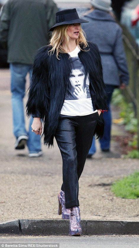Supermodel: Kate Moss was pictured walking in London today