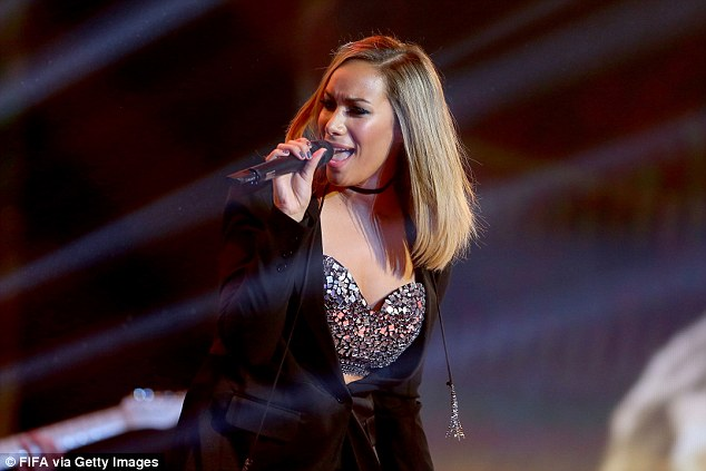 Giving it her all: Leona later showed her support for her event when she performed on stage at the annual bash