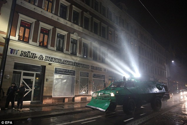 Police forces patrol a street in Leipzig after the peaceful protest turned nasty last night