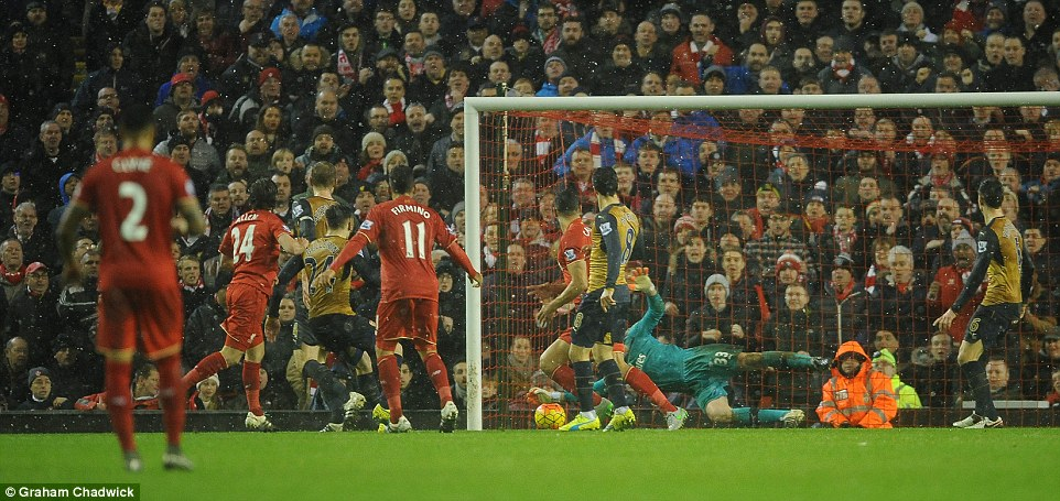 Liverpool midfielder Joe Allen (second left) hauls his side level in the final minute of the game to earn his team a point against Arsenal