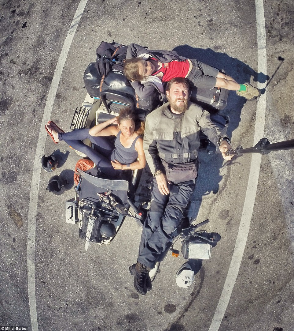 Time for a sunbathe: Mihai captured the moment the travellers took a break in a parking lot in Greece