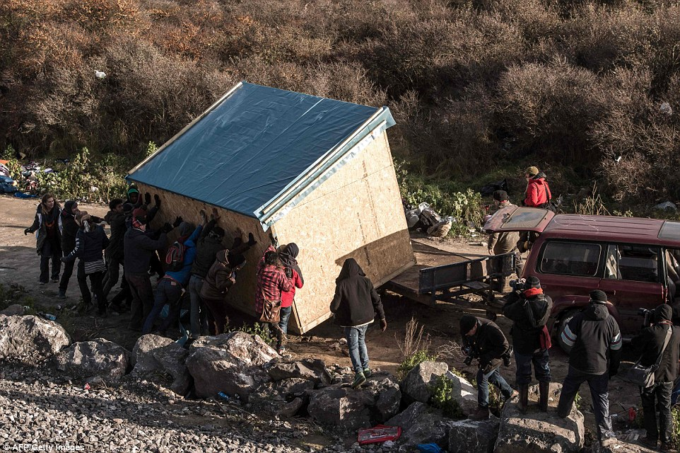 As rumours swirled that bulldozers might show up in the middle of the night, migrants were desperately trying to move their shacks