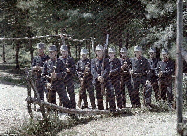 A group of Swiss border guards behind a fence between Switzerland and France, in the Department Haut-Rhin, on 19 June 1917