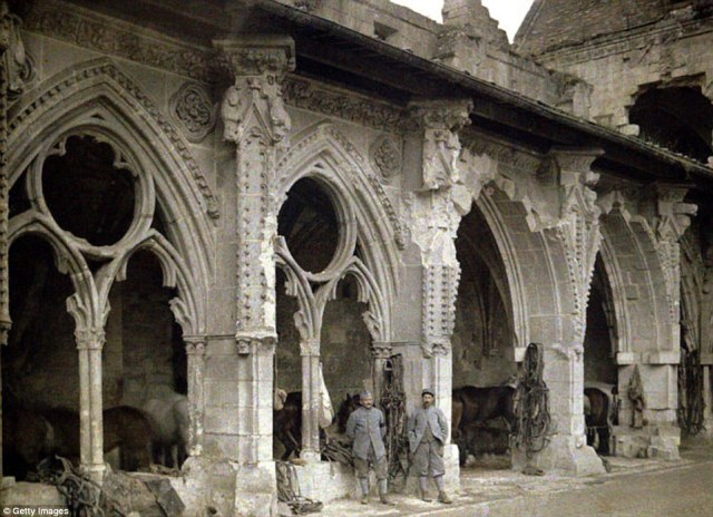 Two French soldiers and horses in the cloister of the abbey de Saint-Jean-des-Vignes, which was heavily damaged by artillery fire