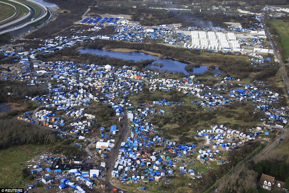 Changes: Aerial view of the Jungle camp shows the new £20million container housing (pictured top right), which will house some 1,500 people who have been living in the part of the camp which is now set to be demolished