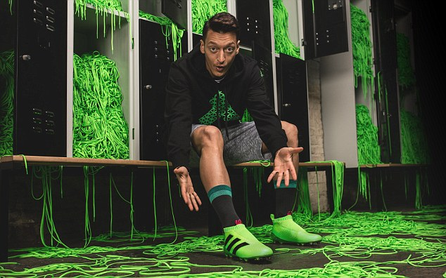 Mesut Ozil has been trying to lessen the impact of laces on his football boots throughout his career