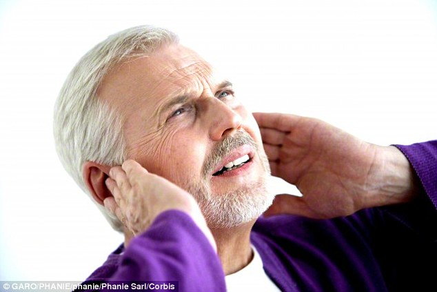 A growing number of people are reported to be suffering from a condition called ultrasound sickness and researchers believe this may be due to a boom in the number of loudspeakers, automatic doors and electronic devices in out every day lives (stock image of a man holding his ears is pictured)