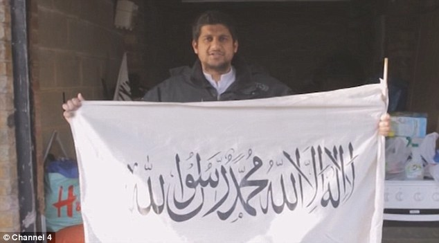 Fanatic: 'Jihadi Sid' holds up another jihadi flag in a Channel 4 documentary 'The Jihadis Next Door'