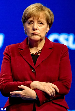 German Chancellor Angela Merkel listens to the speech of Bavarian Prime Minister Horst Seehofer at the CSU Party Congress in Munich, southern Germany