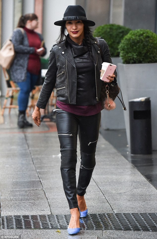 Going hell for leather: Professional Karen Clifton made a stylish entrance, highlighting her dancer's legs in a pair of skin-tight leather trousers which she paired with heels and a battered biker jacket