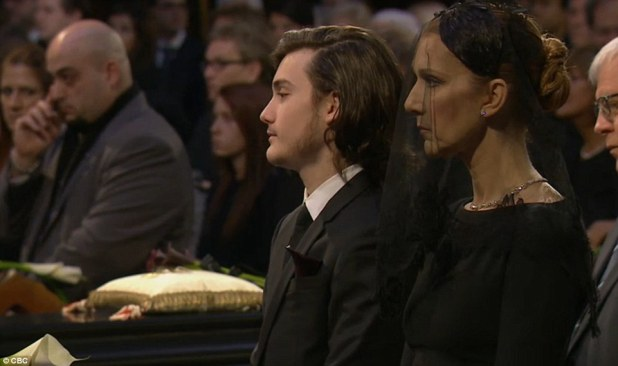 Mom-of-three: Celine was supported throughout the service by her eldest son René Charles, 14, pictured