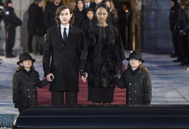 Somber day: Celine Dion stands over the coffin of her husband with their twins Nelson and Eddy and son René Charles