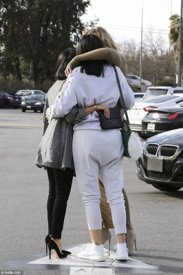 What sisters are for:As the cameras rolled the trio shared a big group hug, with Kourtney finding herself the meat in a very tall sandwich
