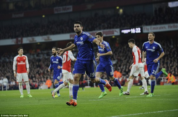 Chelsea striker Diego Costa celebrates his 23rd-minute goal against Arsenal after poking a Branislav Ivanovic cross into the net