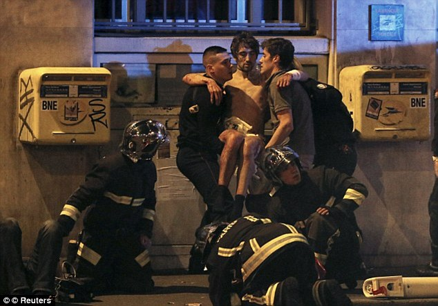Pictured, a man injured in the Paris terror attacks, in last November, is carried to safety by firefighters