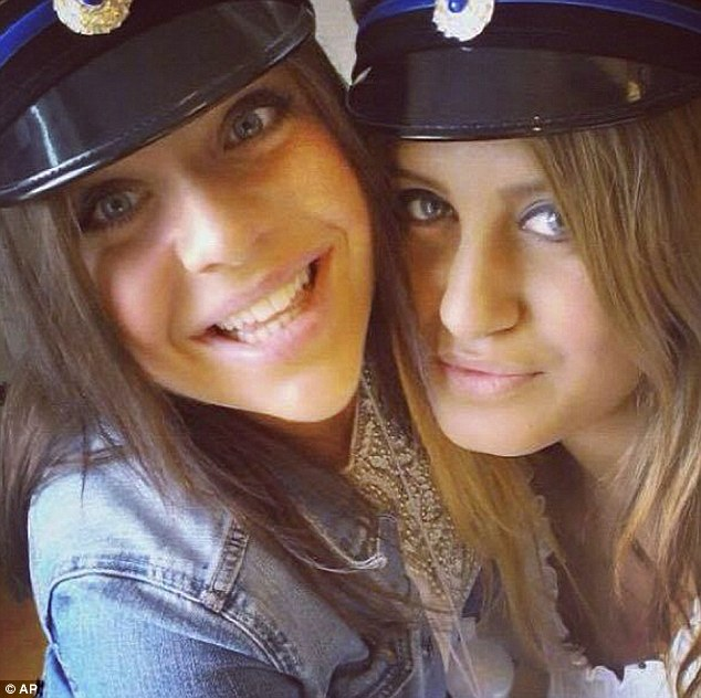 Tragedy: Alexandra Mezher, pictured right with her best friend Lejla Filipovic at their high school graduation in 2012, died after being stabbed at her place of work - a care home for unaccompanied child refugees