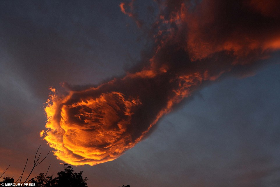 The unusual cloud formation that was spotted over the Portuguese island of Madeira, which has been compared to the 'Hand of God'