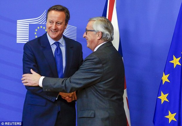 Prime Minister David Cameron is welcomed by European Commission President Jean-Claude Juncke