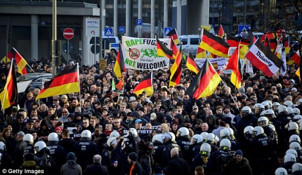 The European Commission wants to remove 'false associations' between the increasing number of some criminal acts and the arrival of migrants, documents show. The attacks prompted a protest by hundreds of people, who waved German flags and carried banners with the slogan 'Rapefugees Not Welcome'