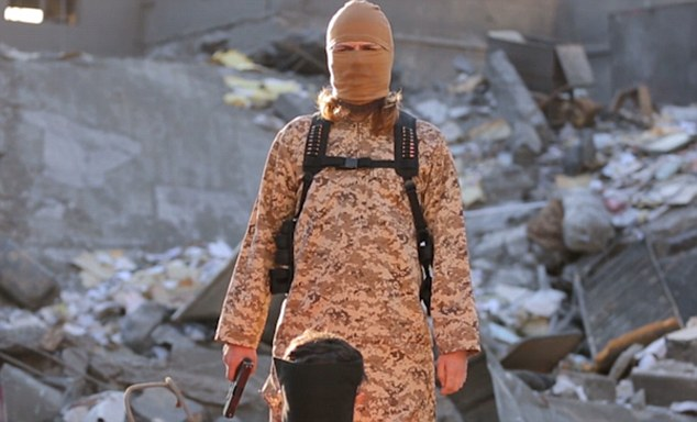 Anger: The white ISIS fighter, concealing his true identity behind a balaclava, warns the terror group are still angry about the overthrow of Muslim rule in southern Spain more than 500 years ago