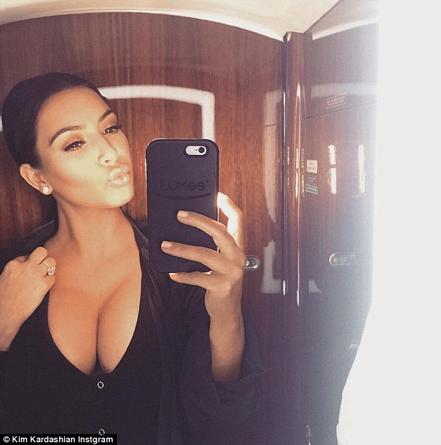 'Hating my huge boobs': Kim Kardashian, pictured in an Instagram snap she shared in January, revealed on her website that she was not a fan of her large cleavage