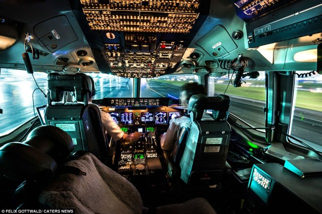 Pilot Felix Gottwald, from Dresden, Germany, is pictured here landing the three-engineMcDonnell Douglas MD-11F aircraft at night
