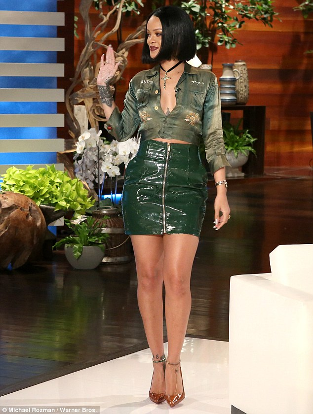 Going green: The singer wore a little green leather skirt and green blouse with plunging neckline
