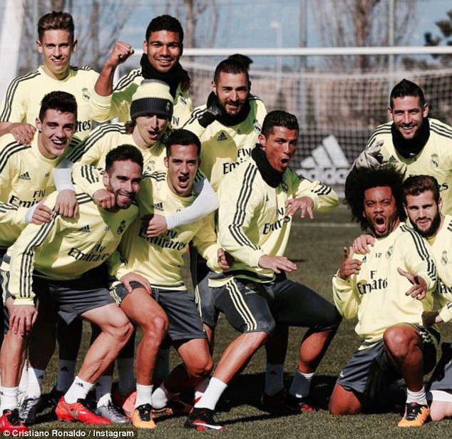 Portugal international Ronaldo (centre) poses with his Real Madrid team-mates on his social media account