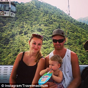 The duo pose with Karen aboard the longest cable car ride in the world in Hong Kong