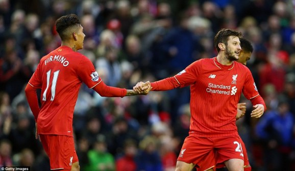 The two goalscorers for Liverpool, Firmino and Lallana, celebrate after their team moved 2-0 ahead against Sunderland