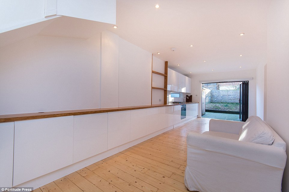 Plenty of space: Despite being just ten feet wide, the living room and kitchen downstairs is open plan and very spacious