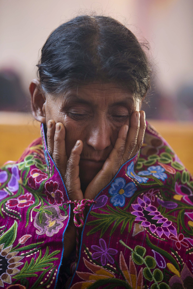 In this Jan. 16, 2016 photo, a Tzotzil Indian prays during a Mass in honor of the Christ of Esquipulas in Chajtoj, Chiapas state, Mexico. Pope Francis¿ Feb. ...