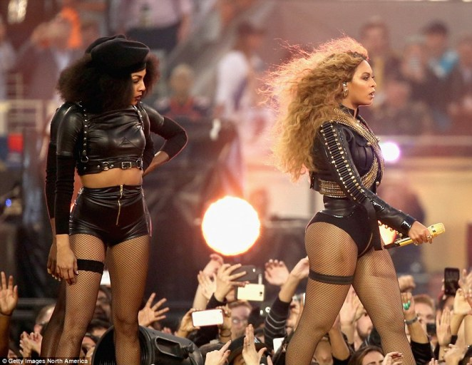 Beyonce used her slot during the Super Bowl 50 halftime show to make a highly political point by performing with backing dancers dressed in the distinctive black berets of the Black Panthers (left)