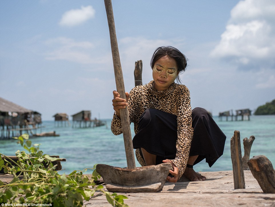 Bajau Laut women like Indda (pictured) wear pounded rice powder to protect their skin from sun damage caused by the water's reflection
