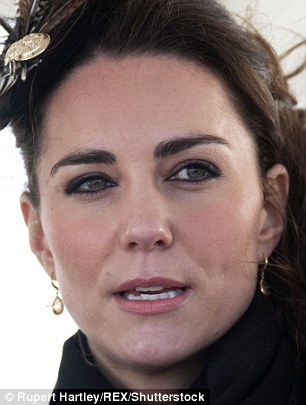 FEBRUARY 2011: Kate's brows are far thicker than we've seen before. She's used an eyebrow pencil to make them so dark they almost match her black scarf. 'They've been filled in quite a lot,' says Shavata. The lack of arch flattens her face and makes her cheeks appear to sag